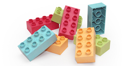 Toy bricks made from plastic-wood composite material