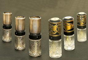 Perfume bottle with plastic perfume atomiser invented by Mr. Peter Florjančič